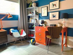 """Using painted stripes in a bright blue on the walls of this child's room added the backdrop for the space. We then added a bright orange desk (complementary color) and accented with grays and wood tones to ground the space."" — Jana Oliveri - PHOTO COURTESY HUE"