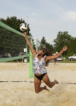 Virgie Downes hits the ball over the net during an Evergreen Region Volleyball Association game. - YOUNG KWAK PHOTO