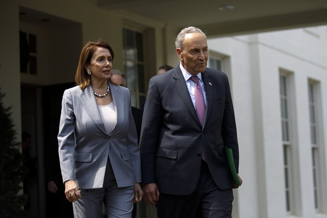 House Speaker Nancy Pelosi (D-Calif.) and House Minority Leader Chuck Schumer (D-N.Y.) approach reporters outside the White House after a meeting about infrastructure with President Donald Trump, at the White House in Washington, April 30, 2019. - TOM BRENNER/THE NEW YORK TIMES