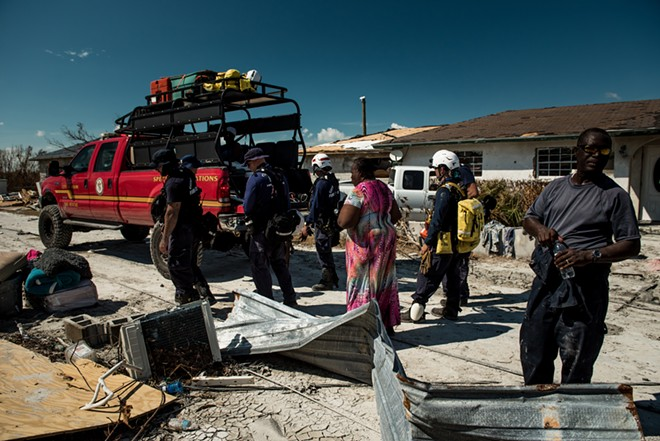 Members of a rescue team from Miami work in McLean's Town, on Grand Bahama, the Bahamas, on Sept. 7, 2019. About 2,500 people have been reported missing in the wake of Hurricane Dorian in the Bahamas, but the names have yet to be checked against those who sought shelter or evacuated. The number of confirmed dead from the storm remained at 50, a figure that government officials say is certain to rise. - MERIDITH KOHUT/THE NEW YORK TIMES