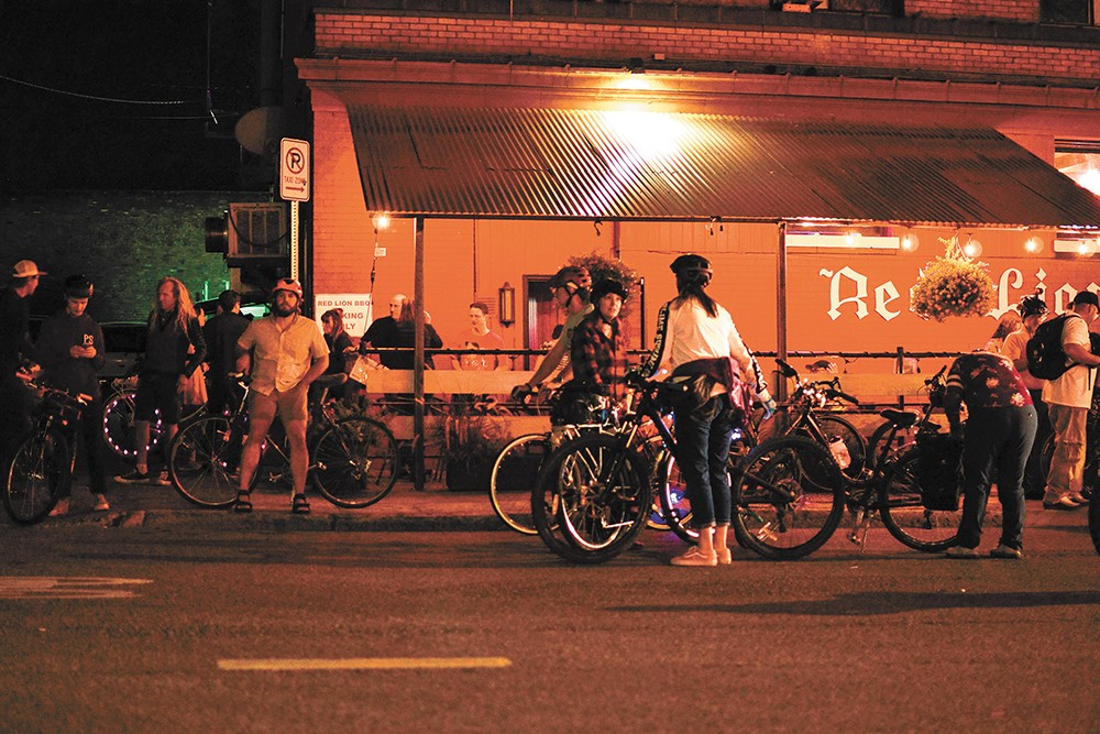 Cyclists outside Red Lion. - JOSH KELETY PHOTO