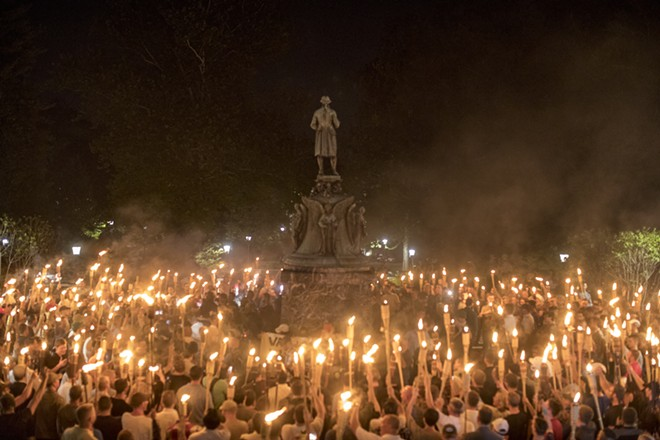 Torch-bearing white nationalists rally around a statue of Thomas Jefferson near the University of Virginia campus in Charlottesville, Aug. 11, 2017. As od late 2019, the Department of Homeland Security is beginning to address white supremacist terrorism as a primary security threat, breaking with a decade of flagging attention after bigoted mass shooters from New Zealand to Texas took the lives of nearly 100 people in the last six months. - EDU BAYER/THE NEW YORK TIMES