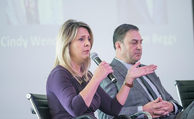 Mayoral candidates Nadine Woodward and Ben Stuckart at last month's Spokane Homeless Coalition forum. - DANIEL WALTERS PHOTO