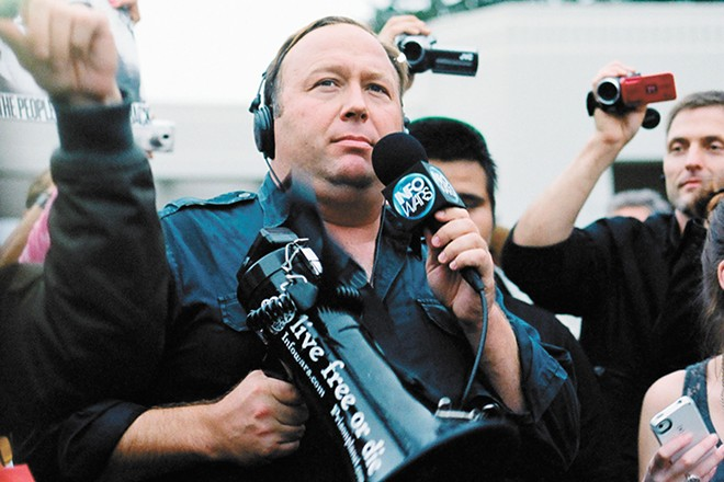 "Millions of people tuned into Alex Jones' red-faced rants about 9/11 being an inside job, Obama chemtrails turning frogs gay, and the Sandy Hook shootings being faked. Donald Trump has been a fan. ""Your reputation is amazing,"" Trump assured Jones on the conspiracy theorist's radio show. ""I will not let you down."" - SEAN P. ANDERSON PHOTO"