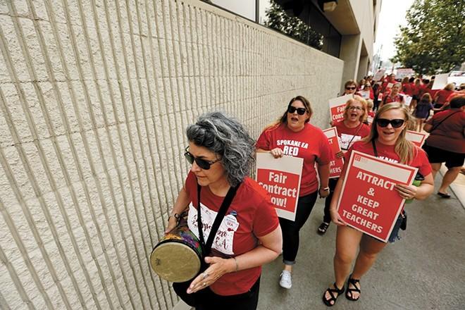 Members of the Spokane Education Association outside of Spokane Public Schools last year. - YOUNG KWAK PHOTO