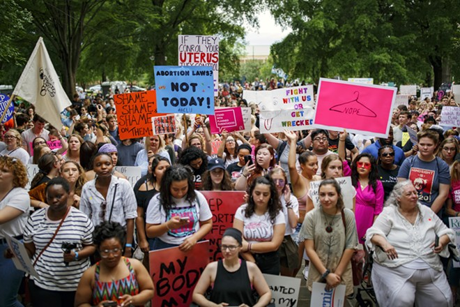 Abortion rights protesters gather in Birmingham, Ala., on May 19, 2019, to protest an Alabama state law that would have made it a felony for doctors to provide abortions in almost all circumstances. A federal judge blocked the near-total ban on abortions on Tuesday, Oct. 29, 2019, stopping the legislation from taking effect next month. - MELISSA GOLDEN/THE NEW YORK TIMES