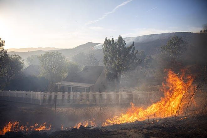 The Easy fire burns along Tierra Rejada Road in Simi Valley, Calif. on Wednesday, Oct. 30, 2019. - KYLE GRILLOT/THE NEW YORK TIMES