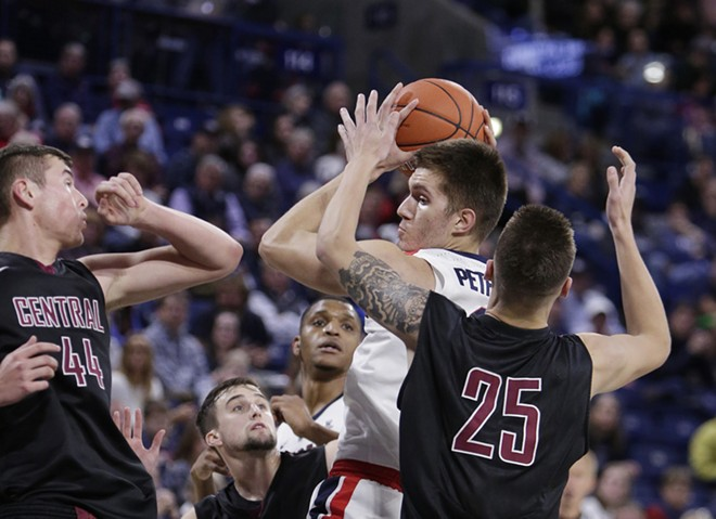 Gonzaga forward Filip Petrusev, center, grabs a rebound against Central Washington in a game last year. - YOUNG KWAK