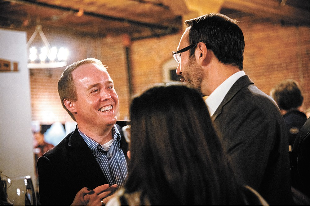 Spokane County Commissioner Josh Kerns, left, celebrates with City Council candidate Michael Cathcart at an election night party at Barrister Winery. - ERICK DOXEY PHOTO