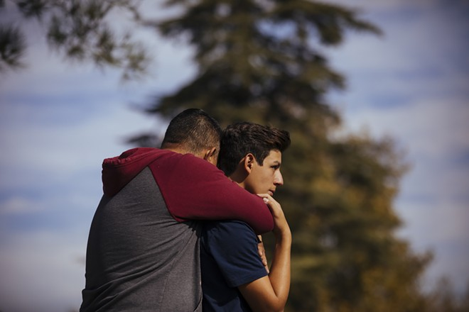 Students are reunited with their parents after a shooting at Saugus High School in Santa Clarita, Calif., on Thursday, Nov. 14, 2019. A 16-year-old student pulled a handgun from his backpack at the school on Thursday morning and shot five students, killing two, the authorities said. The gunman was in grave condition after shooting himself in the head, they said. - DAVID WALTER BANKS/THE NEW YORK TIMES