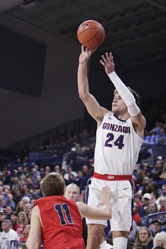 Gonzaga forward Corey Kispert shoots over Lewis-Clark State guard Hodges Bailey during the first half of an exhibition game in Spokane on Nov. 1. - YOUNG KWAK PHOTO