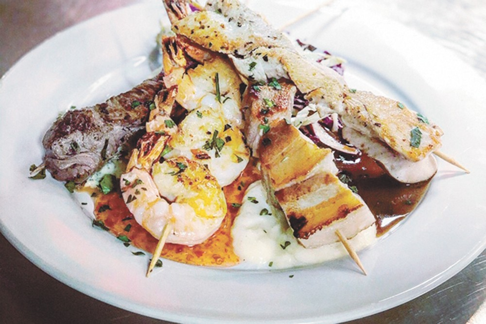 The Pickup Sticks appetizer: sirloin steak, prawns, pork belly and chicken breast skewers.