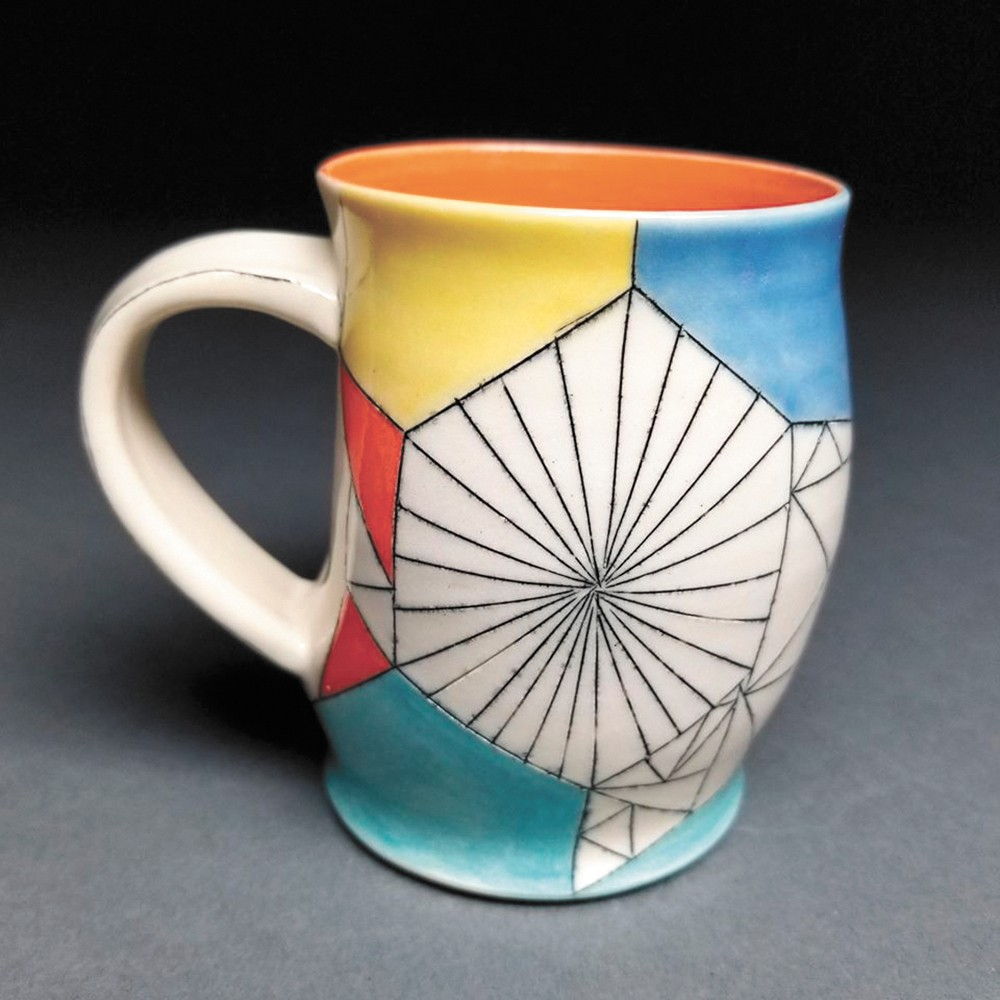 A white stoneware mug from Aubrey Purdy Rude for Trackside Studio's annual Cup of Joy show.