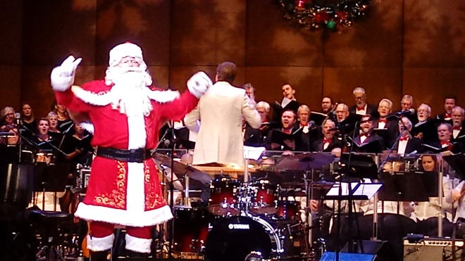 Santa led the audience in some carols before Vanessa Williams took the stage. - DAN NAILEN PHOTO