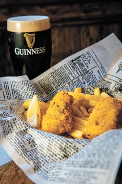 Two-piece fish and chips with a Guinness. - ERICK DOXEY PHOTO