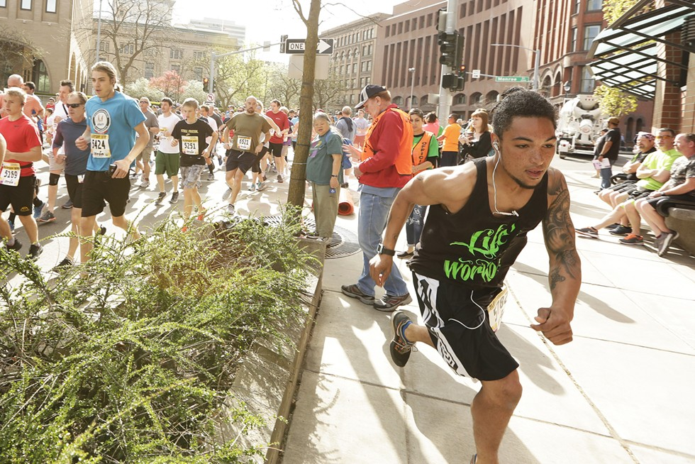 Josh Morrow runs on Riverside Avenue during the 43rd annual Bloomsday run in May. - YOUNG KWAK