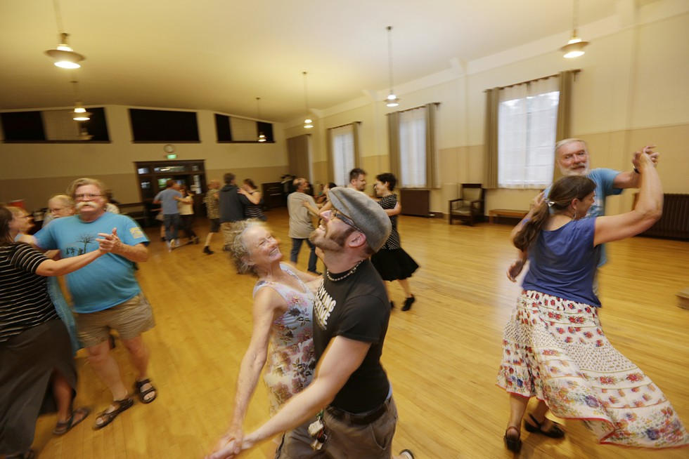 Anita Morgan, center left, and Ryan Nichols dance in June during a contra dance at the Spokane Woman's Club. - YOUNG KWAK PHOTO