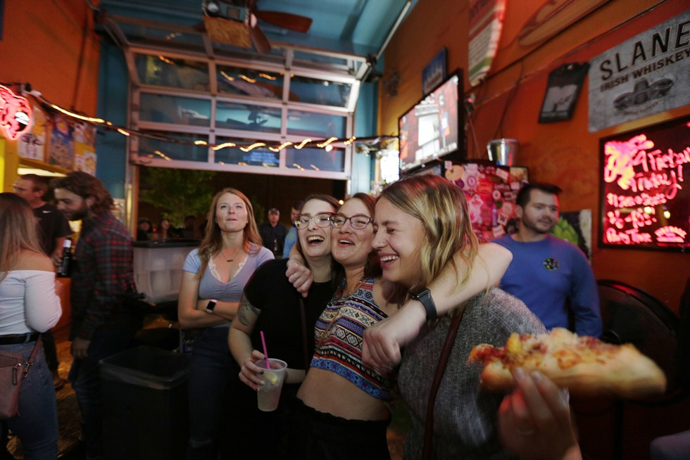 Rhiannon Lehde, Angela Mascall and Michelle Miller sing along with a karaoke singer at the Monterey Cafe on Friday the 13th in September. - YOUNG KWAK PHOTO