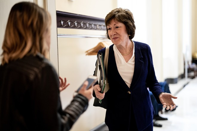 """Sen. Susan Collins (R-Maine) talks to a reporter en route to a policy luncheon on Capitol Hill in Washington, Oct. 22, 2019. In a radio interview broadcast on Dec. 30, Collins specifically referenced Sen. Majority Leader Mitch McConnell in criticizing Senate colleagues who """"prejudge the evidence"""" in impeachment proceedings against the president. - ERIN SCHAFF/THE NEW YORK TIMES"""