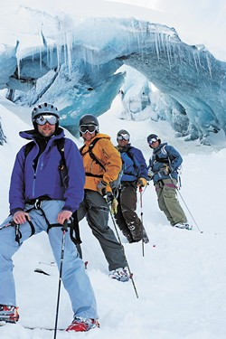 The author rented an RV with three friends (left) to travel the Alaskan highways in search of untouched powder.