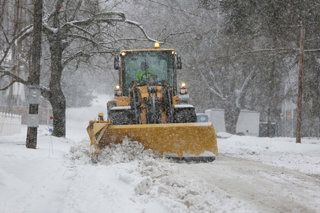 A city of Spokane Street Department loader, with its Hi-Gate down, plows snow on S. Helena St. - YOUNG KWAK PHOTO