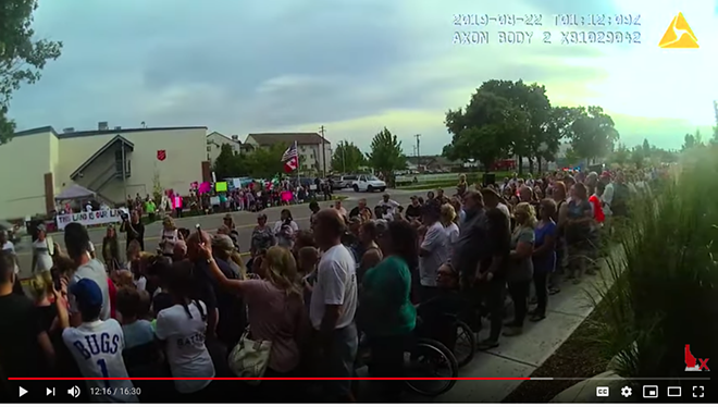 A screenshot from a compilation of Spokane Police body cam footage at a protest outside Planned Parenthood in August 2019, as posted to the right-wing YouTube page North Idaho Exposed. - SPOKANE POLICE BODY CAM FOOTAGE OBTAINED BY NORTH IDAHO EXPOSED