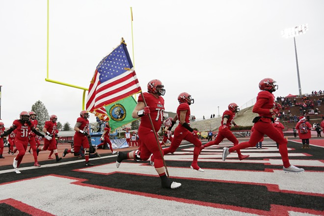 Eastern Washington offensive lineman Matt Meyer (70) and his teammates run onto the field before an NCAA Football Champion Subdivision quarterfinal game in Cheney, Wash., Saturday, Dec. 8, 2018. - YOUNG KWAK PHOTO