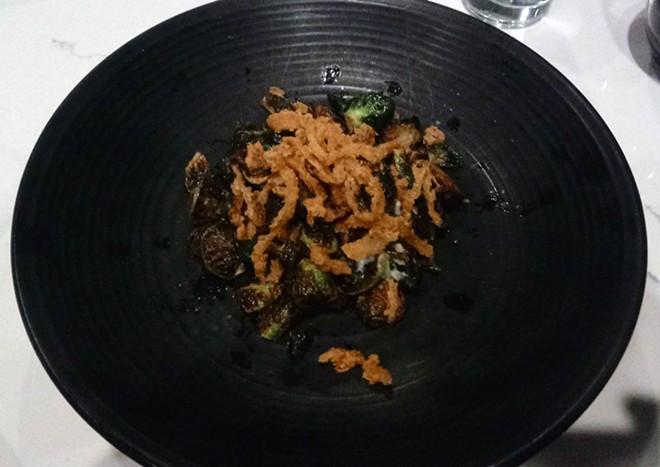 This picture doesn't do the crispy Brussels sprouts justice. The dijon gastrique and crispy onions are great additions. - DAN NAILEN PHOTO