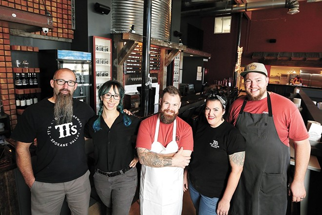 Chef Chad White, center, with the team at TTs Old Iron Brewery & Barbecue, opened in 2019. - YOUNG KWAK
