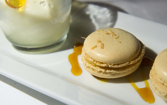 """Housemade lemon sorbet served with a couple of coconut Parisian macarons filled with pineapple curd"" - DANIEL WALTERS PHOTO"