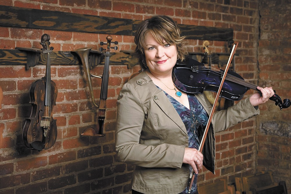 Eileen Ivers puts her fiddle's strangs to masterful use.