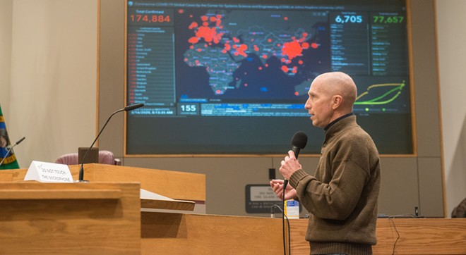 Spokane County Health Officer Bob Lutz stands in front of an extremely foreboding map - DANIEL WALTERS PHOTO