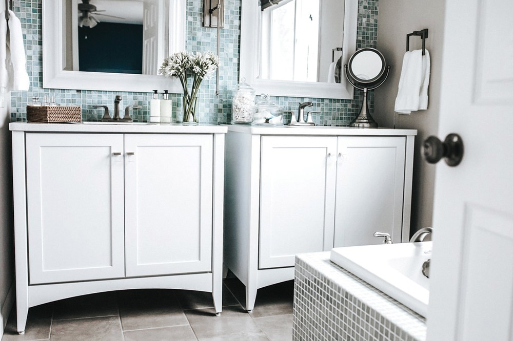 One home can house many moods, as these two bathrooms in designer Deanna Goguen's house demonstrate. - ALICIA HAUFF