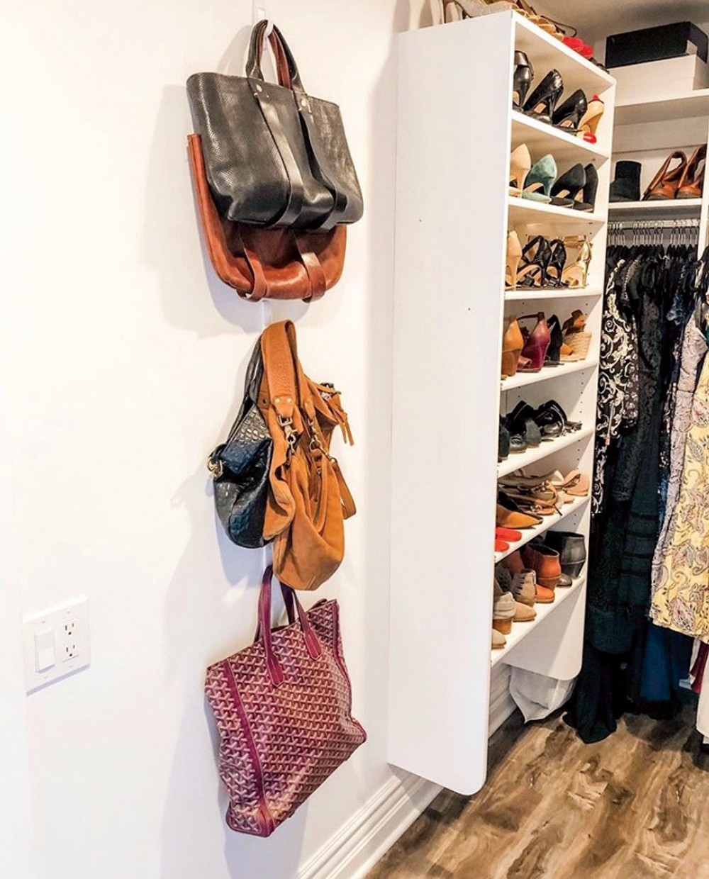 Use hooks to store handbags, and alternate shoes front to back to save space. - KARA DIXON