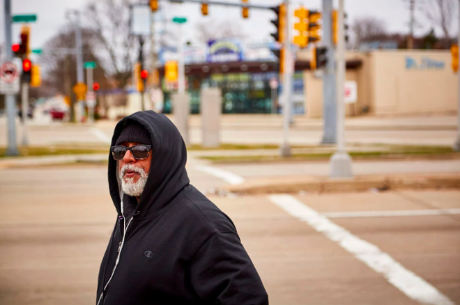 Fred Royal, the Milwaukee head of the NAACP, walks empty streets near his home in a largely black neighborhood hit hard by the coronavirus. He knows three people who have died. - DARREN HAUCK FOR PROPUBLICA