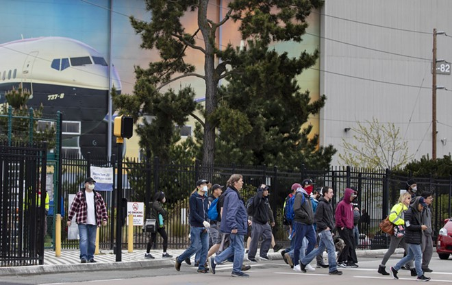Boeing employees leave the property during a shift change at the plant in Renton, Wash., Tuesday, April 28, 2020. The breathtaking slowdown in global aviation is taking a huge toll on Boeing, which said on Wednesday that it would slash about 16,000 jobs after reporting that revenue tumbled by 26 percent in the first three months of the year. - RUTH FREMSON/THE NEW YORK TIMES