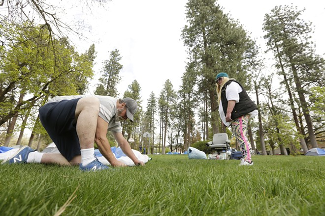 A makeshift tent city went up at Coeur d'Alene Park in Spokane on Thursday. - YOUNG KWAK PHOTO