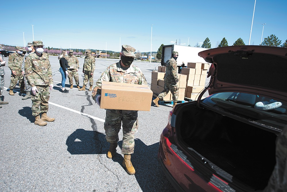 Members of the Washington National Guard distribute food from Second Harvest Food Bank on April 16. - MICHAEL BROWN/WASHINGTON NATIONAL GUARD PHOTO