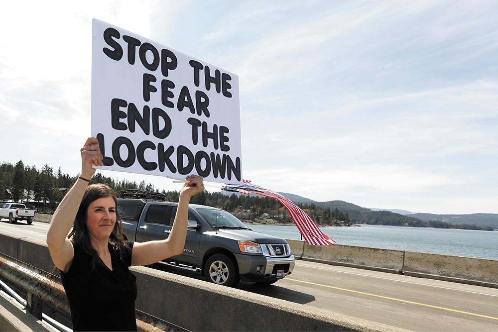 Outside of Sandpoint, Kay Jorissen joined other protesters marching against Idaho's stay-home order on April 17. - YOUNG KWAK PHOTO