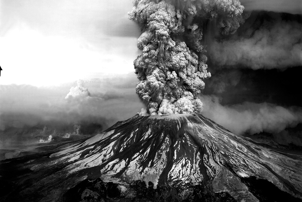 Mount St. Helens continued to spew ash into the sky for nine hours after the initial 8:32 am eruption. This aerial view shows the mountain's southwest side. - ROBERT KRIMMEL PHOTO