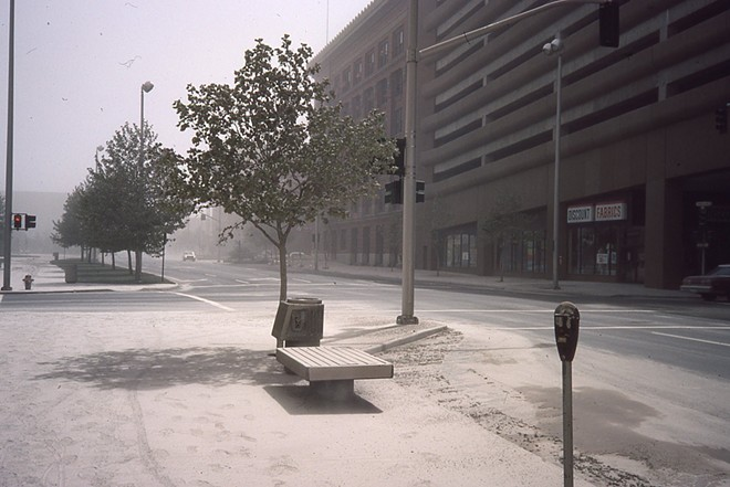 Downtown Spokane seen dusted in ash the following day, Monday, May 19, 1980. This photo was taken at the corner of Post St. and Spokane Falls Blvd., at City Hall, looking east. - COURTESY ROGER CRUM
