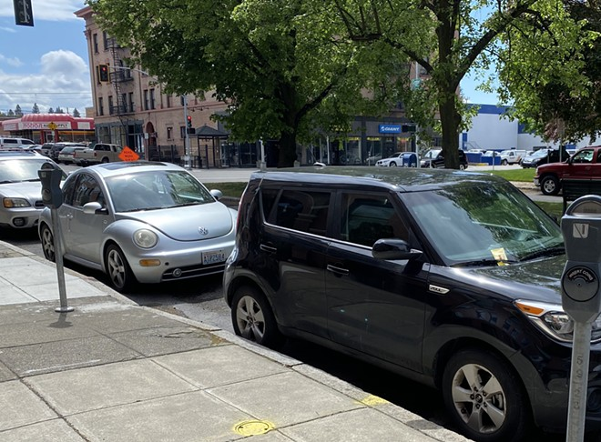 If you thought that Spokane meter time limits weren't being enforced while meter parking fare wasn't being collected, you'd be wrong, apparently. - SAMANTHA WOHLFEIL PHOTO