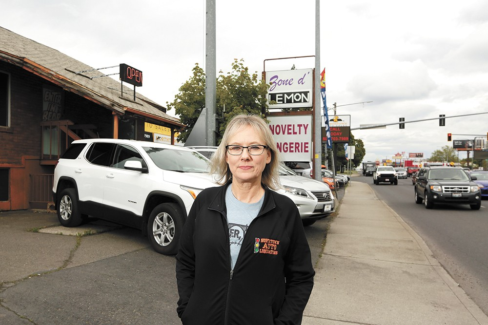 Kim Arrotta, co-owner of Northtown Auto Sales, is frustrated that a next-door business, a sex shop, has remained open throughout the shutdown. - YOUNG KWAK PHOTO
