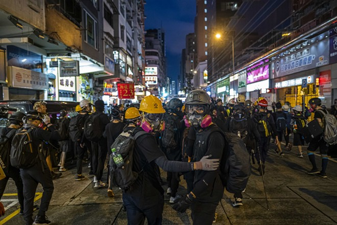 Protesters outside the Mong Kok police station in Hong Kong, Aug. 17, 2019. China is moving to impose new national security laws that would give the Communist Party more authority in Hong Kong, a proposal announced on May 21, 2020. - LAM YIK FEI/THE NEW YORK TIMES