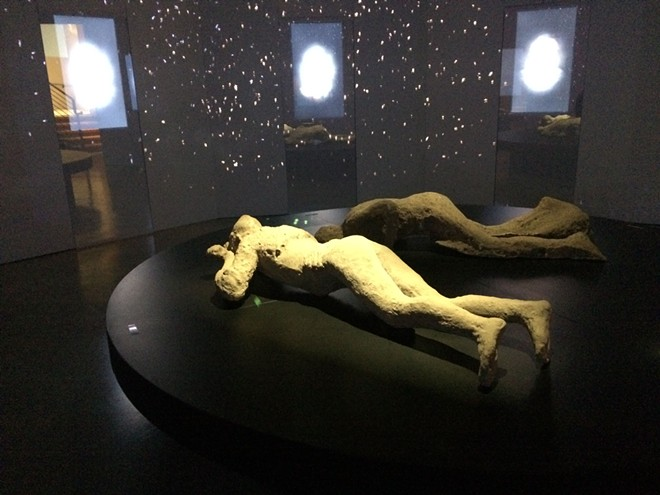 Replica body casts of victims of Mount Vesuvius's 79 AD eruption are included in the touring exhibit Pompeii: The Immortal City, now extended at the MAC through Sept. 6 - COURTESY OF THE MAC