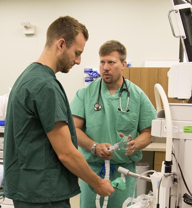 Dr. Geoff Jones (right) with a UW student. - UW SCHOOL OF MEDICINE