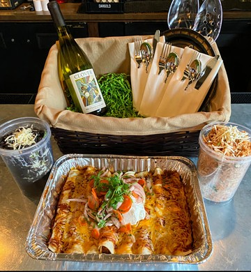 Clover's new summer menu includes family-style and picnic-friendly meals; pictured here are chicken enchiladas available to-go or for delivery. - CLOVER