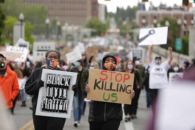 Protesters marching in the street today. - YOUNG KWAK PHOTO