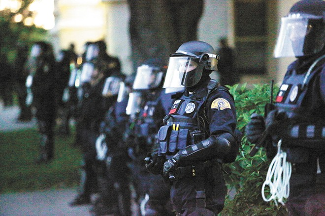 Law enforcement officers in tactical gear during Sunday's peaceful protest outside the Spokane County Courthouse. - YOUNG KWAK PHOTO