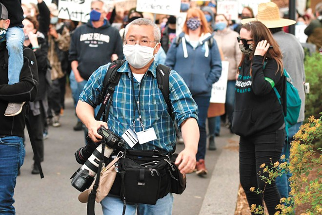 Inlander staff photographer Young Kwak has been covering local protests for the past three weeks. - MYK CRAWFORD PHOTO